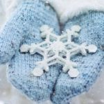Girl holding a snowflake