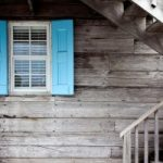 Old window with blue shutters