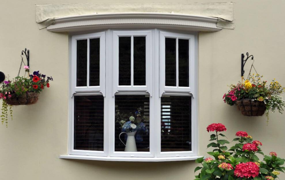White bow windows with mock sash detail