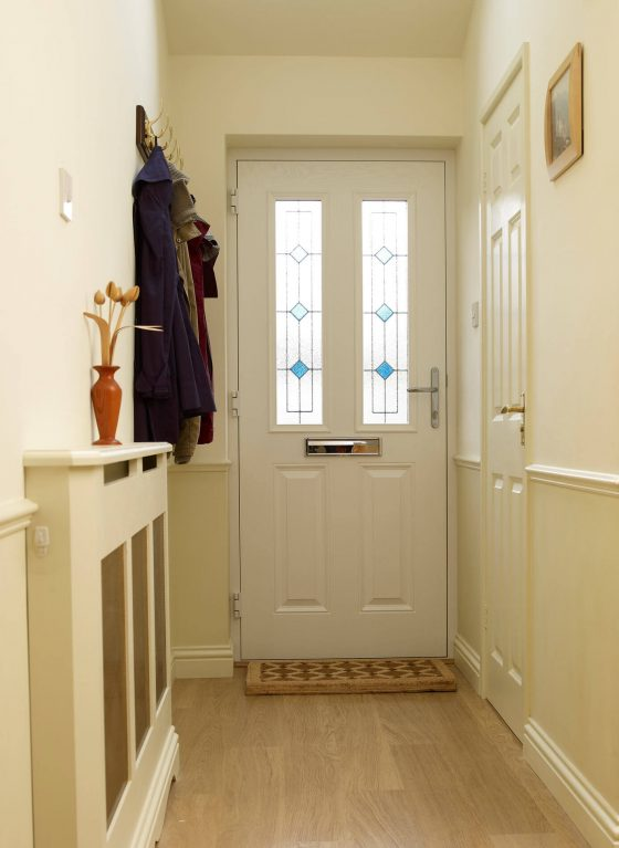 Internal view of white composite front door with decorative glass