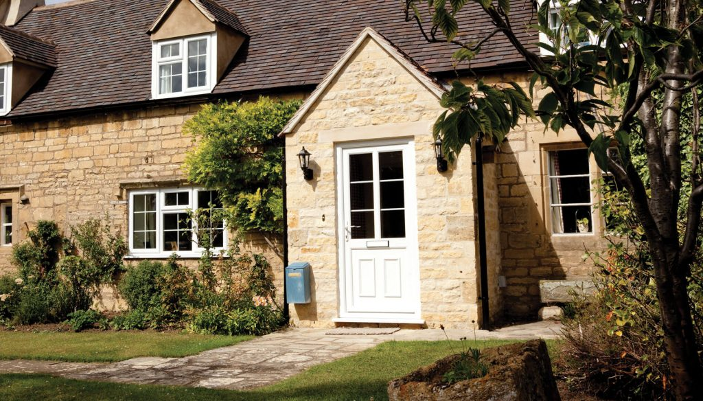 Traditional style home with a white uPVC door with a large glazed pane and astragal bar detail