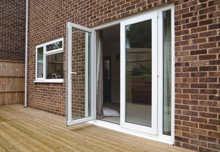 A white uPVC french door with one panel open