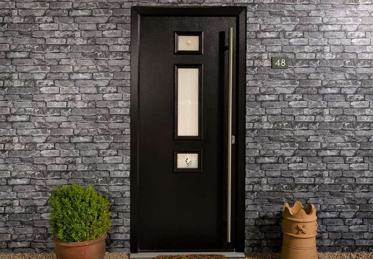 A modern composite front door with glazed panels