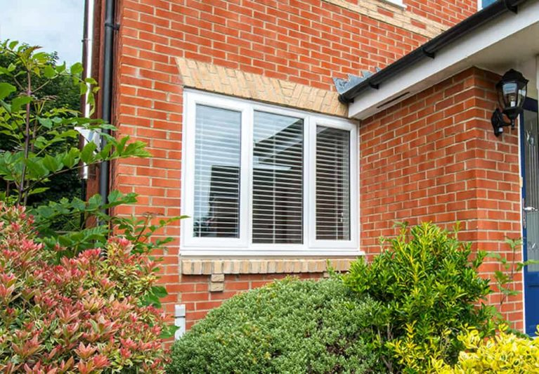 External view of standard double glazed windows with blinds
