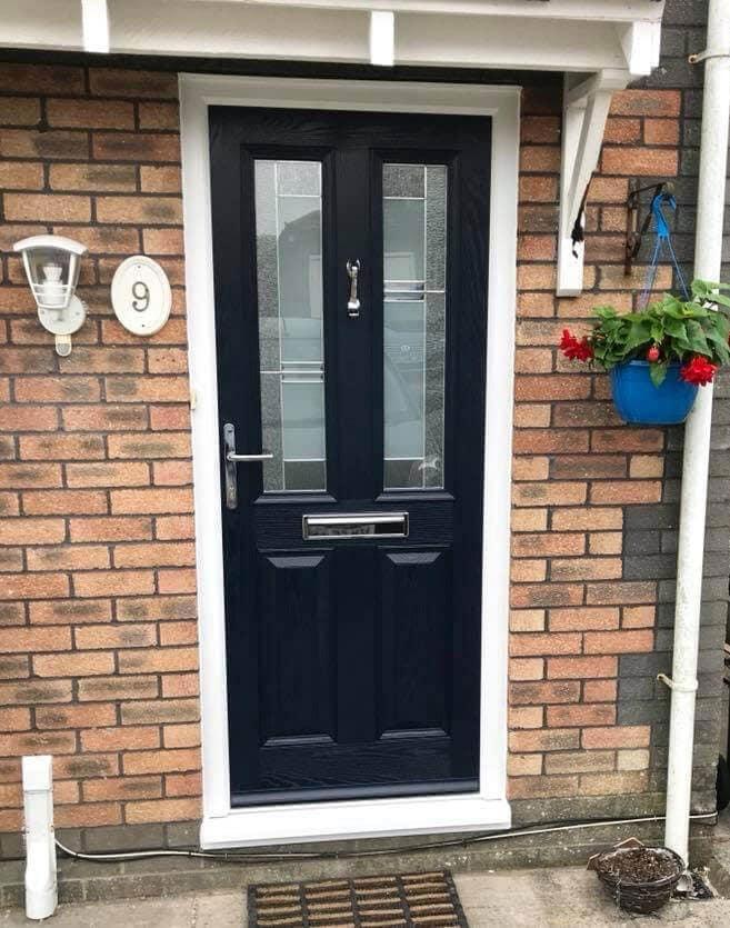 Black front door with modern glazing pattern