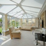 Large conservatory with glazed roofs and blinds installed