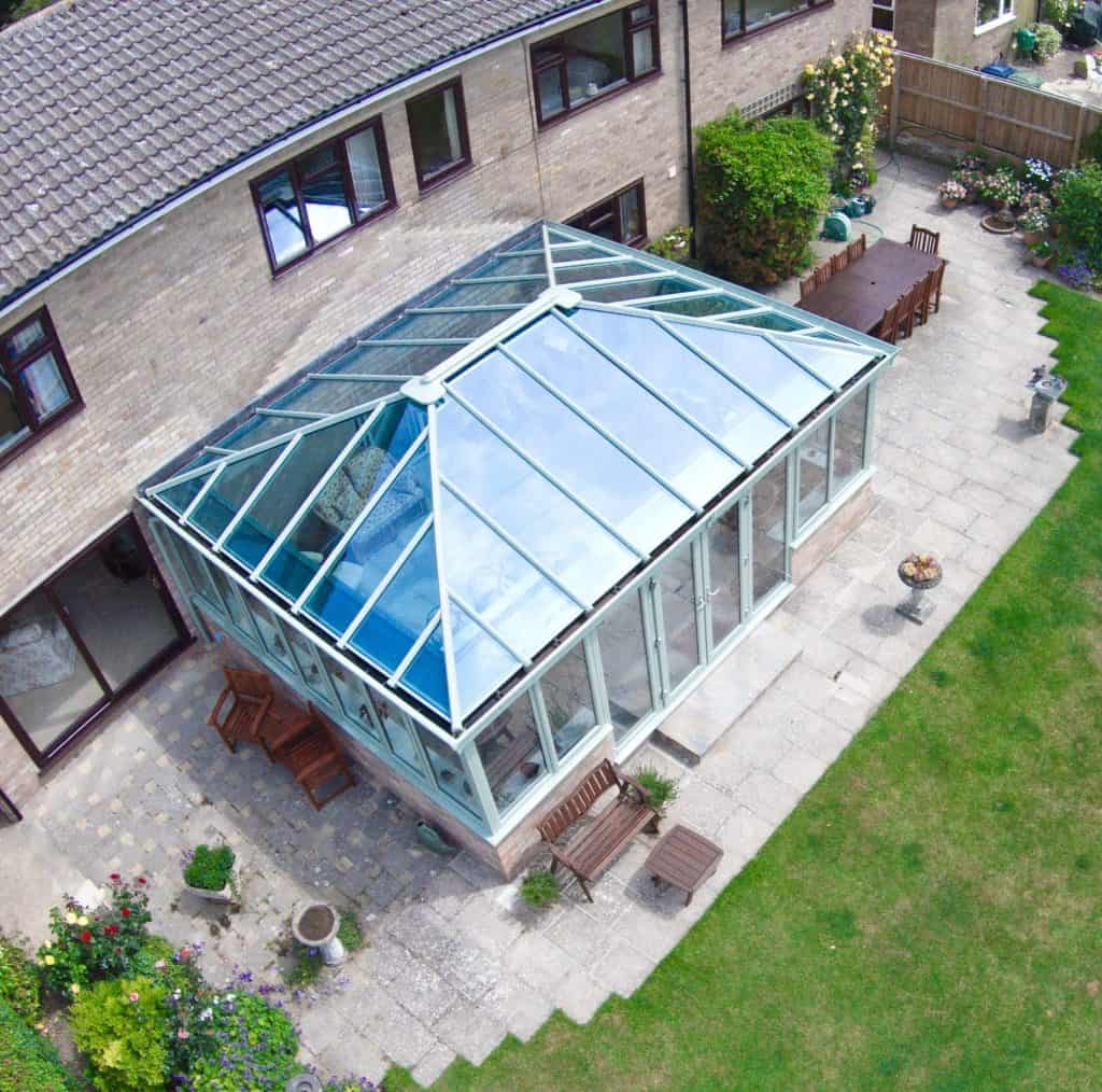 A large edwardian conservatory with glazed roof